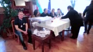Turkeybased Bulgarian citizens cast their ballots for the Bulgarian parliamentary elections at the Bulgarian Consulate in Edirne Turkey on March 26...