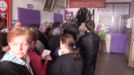 Turkeybased Bulgarian citizens cast their ballots for the Bulgarian parliamentary elections at a polling station in Izmir Turkey on March 26 2017...
