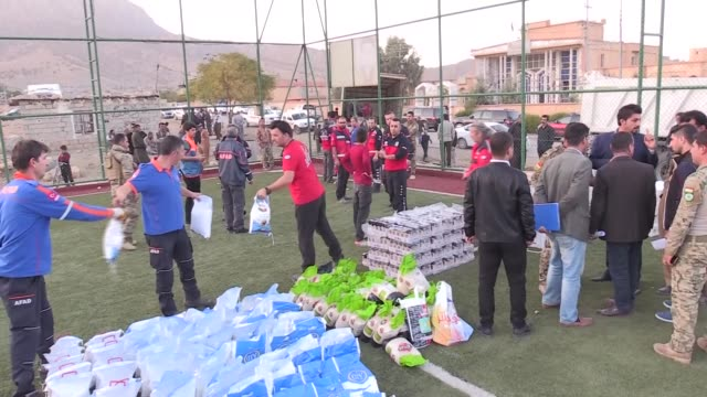 Turkey's Disaster and Emergency Management Authority distributes basic humanitarian aid to 250 quakehit families in Iraq's northern province of...