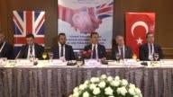 Turkey's EU Minister Omer Celik speaks next to Muslim Council of Britain Secretary General Harun Khan and President of the Board of Deputies of...