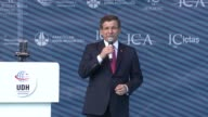 Turkey's former Prime Minister Ahmet Davutoglu delivers a speech during the opening ceremony of the Yavuz Sultan Selim bridge in Istanbul Turkey on...