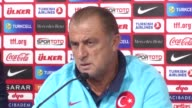 Turkey's head coach Fatih Terim speaks during a press conference next to his player Sener Ozbayrakli in Zagreb Croatia on September 04 2016 Turkey...