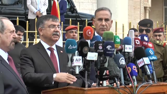 Turkey's National Defense Minister Ismet Yilmaz meets Iraq's Defence Minister Khaled alObeidi on March 4 2015 at the Ministry of Defence in Baghdad...