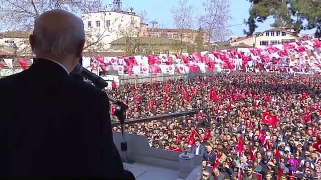 Turkey's Nationalist Movement Party's leader Devlet Bahceli addresses the crowd during a meeting prior to the constitutional referendum which comes...