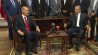 Turkey's new Deputy Prime Minister Fikri Isik takes over his new post Numan Kurtulmus during a handover ceremony in Ankara Turkey on July 20 2017...