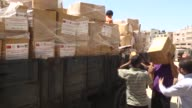 Turkey's Presidency of Religious Affairs and Turkish Cooperation and Coordination Agency deliver food aid packages to the Palestinians in Shuja'iyya...