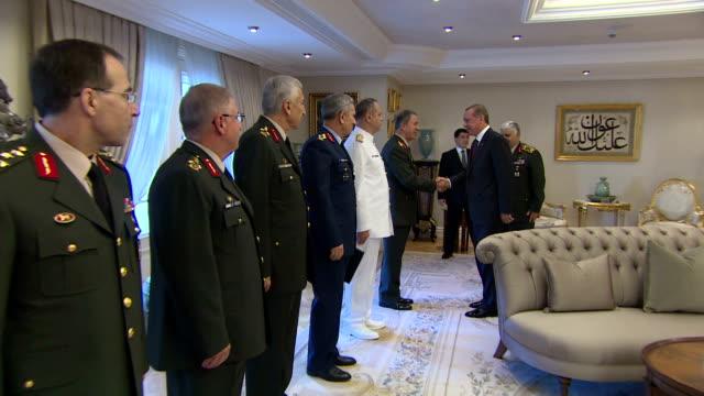 Turkey's President Recep Tayyip Erdogan receives Turkey's Land Forces Commander Hulusi Akar Commander of the Turkish Naval Forces Full Admiral Bulent...