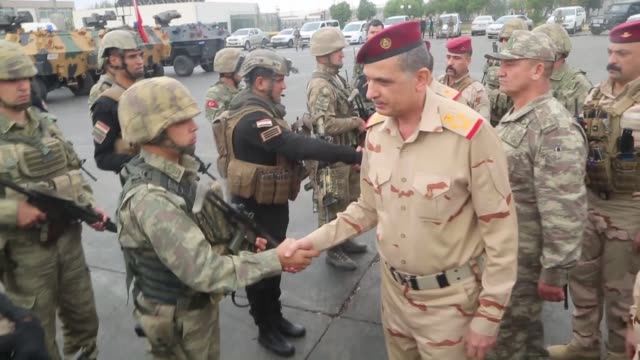 Turkey's Second Army Commander Gen Ismail Metin Temel and Iraqi Army Chief of Staff Gen Othman alGhanimi greet Turkish and Iraqi soldiers upon their...