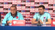 Turkey's Sener Ozbayrakli speaks during a press conference next to head coach Fatih Terim in Zagreb Croatia on September 04 2016 Turkey will face...