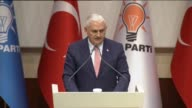 Turkey's Transport Maritime and Communications Minister Binali Yildirim delivers a speech after being announced as candidate for Justice and...