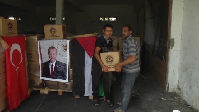 Turkish aid packages are distributed to 29000 Palestinian families by Palestinian Ministry of Social Development in the blockaded Gaza Strip on July...