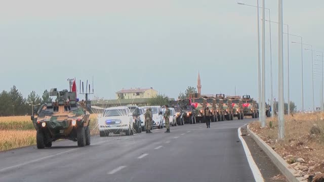 Turkish and Iraqi soldiers are advancing towards the Habur border crossing which also is known as Halil Ibrahim with Turkish and Iraqi flags on...