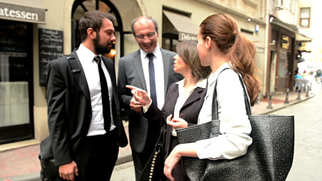 Turkish Business People Talking Outside