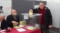 Turkish citizens living in Germany cast their ballots for the upcoming Turkish constitutional referendum at a polling station in Cologne Germany on...