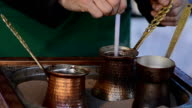Turkish coffee in hot sand - Stock Video