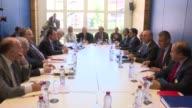 Turkish Cypriot President Mustafa Akinci Turkish Foreign Minister Mevlut Cavusoglu GreekCypriot leader Nicos Anastasiades Greek Foreign Minister...