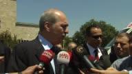 Turkish Deputy Prime Minister Numan Kurtulmus and Justice and Development Party MP Samil Tayyar talk to journalists after Turkey's parliament...