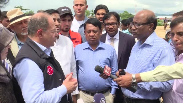Turkish Deputy Prime Minister Recep Akdag distributes aids among Rohingya Muslims during his visit to a refugee camp in Bangladesh on September 27...