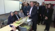 Turkish Deputy Prime Minister Tugrul Turkes casts his ballot for the constitutional referendum at a polling station in Ankara Turkey on April 16 2017...