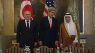 Turkish Foreign Minister Feridun Sinirlioglu US Secretary of State John Kerry and Saudi Arabia's Foreign Minister Adel alJubeir arrive for a meeting...