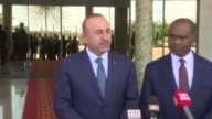 Turkish Foreign Minister Mevlut Cavusoglu and Burkina Faso's Minister of Foreign Affairs Alpha Barry attend a joint press conference after their...