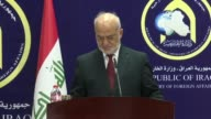 Turkish Foreign Minister Mevlut Cavusoglu and Iraqi Foreign Minister Ibrahim alJaafari attend a joint press conference after their meeting in Baghdad...