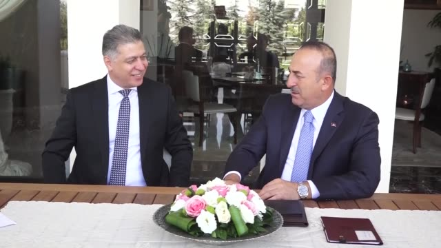 Turkish Foreign Minister Mevlut Cavusoglu and Iraqi Turkmen Front leader Ershad Salihi hold a meeting in Ankara Turkey on September 15 2017