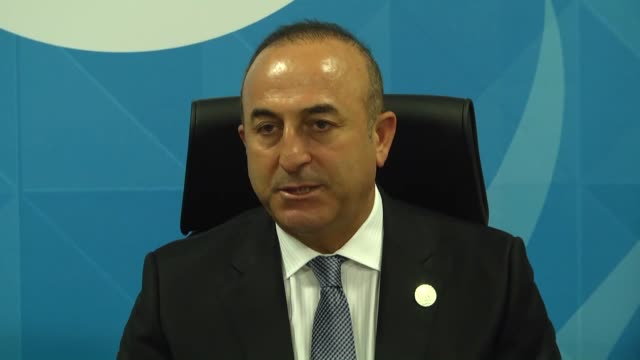 Turkish Foreign Minister Mevlut Cavusoglu and Saudi Minister of Foreign Affairs Adel alJubeir attend the signing ceremony of an agreement on the...