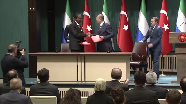 Turkish Foreign Minister Mevlut Cavusoglu and Sierra Leonean Foreign Minister Samura Kamara sign a cooperation agreement between Turkey and Sierra...