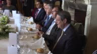 Turkish Foreign Minister Mevlut Cavusoglu attends a luncheon with Foreign Affairs Minister of Greece Nikos Kotzias Greek Cypriot leader Nikos...