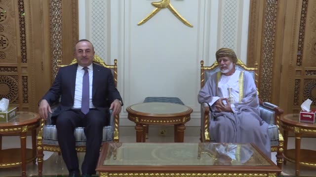 Turkish Foreign Minister Mevlut Cavusoglu is welcomed by Omani Minister Responsible for Foreign Affairs Yusuf bin Alawi bin Abdullah upon his arrival...