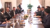 Turkish Foreign Minister Mevlut Cavusoglu meets with General Coordinator of the Syrian opposition's High Negotiating Committee Riad Hijab at Foreign...
