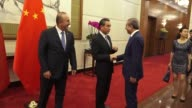 Turkish Foreign Minister Mevlut Cavusoglu meets with his Chinese counterpart Wang Yi in Beijing China on August 03 2017