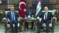 Turkish Foreign Minister Mevlut Cavusoglu meets with his Iraqi counterpart Ibrahim alJaafari in Baghdad Iraq on August 23 2017