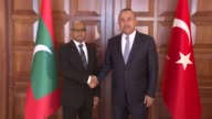 Turkish Foreign Minister Mevlut Cavusoglu meets with his Maldivian counterpart Mohamed Asim in Ankara Turkey on August 29 2017