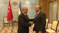 Turkish Foreign Minister Mevlut Cavusoglu meets with his Uzbek counterpart Abdulaziz Komilov during his official visit in Tashkent Uzbekistan on...