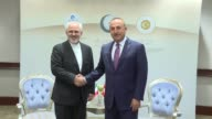 Turkish Foreign Minister Mevlut Cavusoglu meets with Iranian Foreign Minister Mohammad Javad Zarif ahead of the Organization of Islamic Cooperation...
