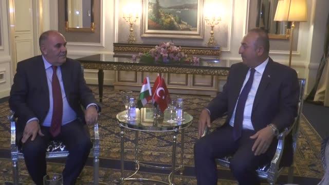 Turkish Foreign Minister Mevlut Cavusoglu meets with Iraqi Kurdish Regional Government Deputy Prime Minister Qubad Talabani and Sadi Ahmed Pire a...