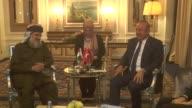 Turkish Foreign Minister Mevlut Cavusoglu meets with Irfan Ali Abdulaziz the leader of the Islamic Movement in Kurdistan on August 23 2017 in Erbil