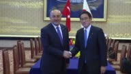 Turkish Foreign Minister Mevlut Cavusoglu meets with Japanese Foreign Minister Fumio Kishida in Tokyo Japan on June 21 2017