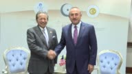Turkish Foreign Minister Mevlut Cavusoglu meets with Malaysian Foreign Minister Dato' Sri Anifah Aman ahead of the Organization of Islamic...