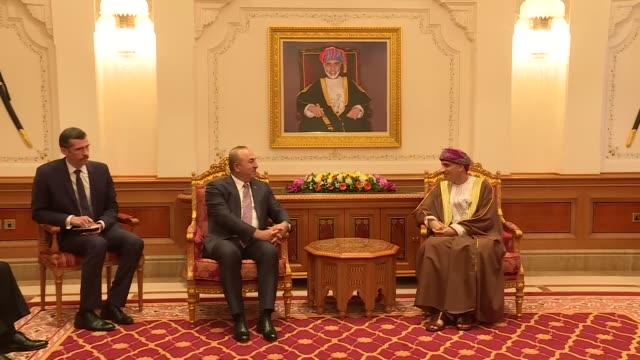 Turkish Foreign Minister Mevlut Cavusoglu meets with Oman's Deputy Prime Minister Fahd bin Mahmoud alSaid in Muscat Oman on October 29 2017 Omani...