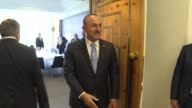 Turkish Foreign Minister Mevlut Cavusoglu meets with Turkish Cypriot President Mustafa Akinci during the third day of the Cyprus Conference in...