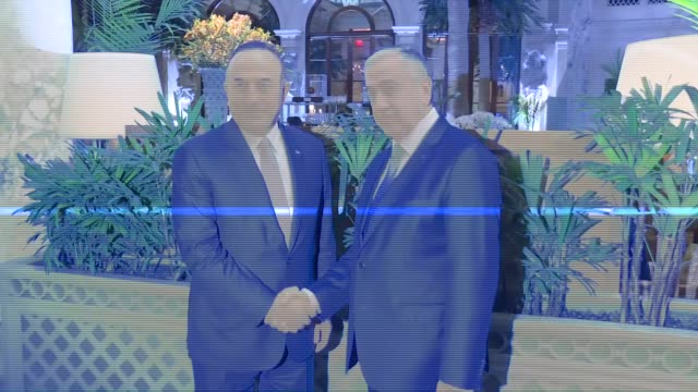 Turkish Foreign Minister Mevlut Cavusoglu meets with Turkish Cypriot leader Mustafa Akinci during his official visit in New York United States on...