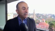 Turkish Foreign Minister Mevlut Cavusoglu on March 2017 in Antalya southern Turkey says the banner calling for the murder of President Recep Tayyip...