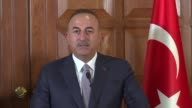 Turkish Foreign Minister Mevlut Cavusoglu speaks at a joint press conference with his Pakistani counterpart Khawaja Muhammad Asif following their...