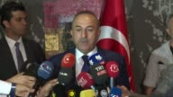 Turkish Foreign Minister Mevlut Cavusoglu speaks to the journalists after meeting with Northern Iraq's Kurdish Regional Government President Masoud...