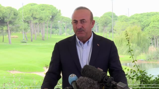 Turkish Foreign Minister Mevlut Cavusoglu speaks to the media following a trilateral meeting with his Russian counterpart Sergey Lavrov and Iranian...