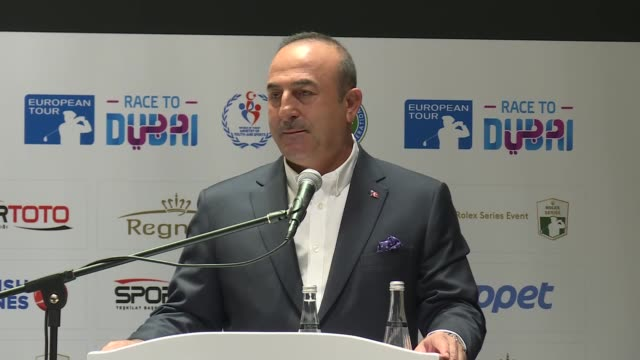 Turkish Foreign Minister Mevlut Cavusoglu Turkish Golf Federation President Ahmet Agaoglu and owner of Regnum Carya Golf and Spa Resort Fikret Ozturk...