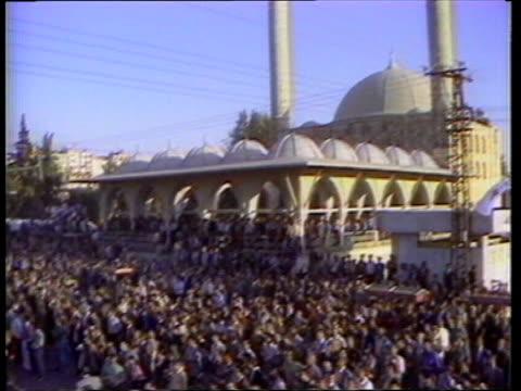 Adana CMS Turgut Ozal speaking AV Mosque TILT DOWN to massed crowd CMS Ozal pamphlet MS Office PAN MS TV